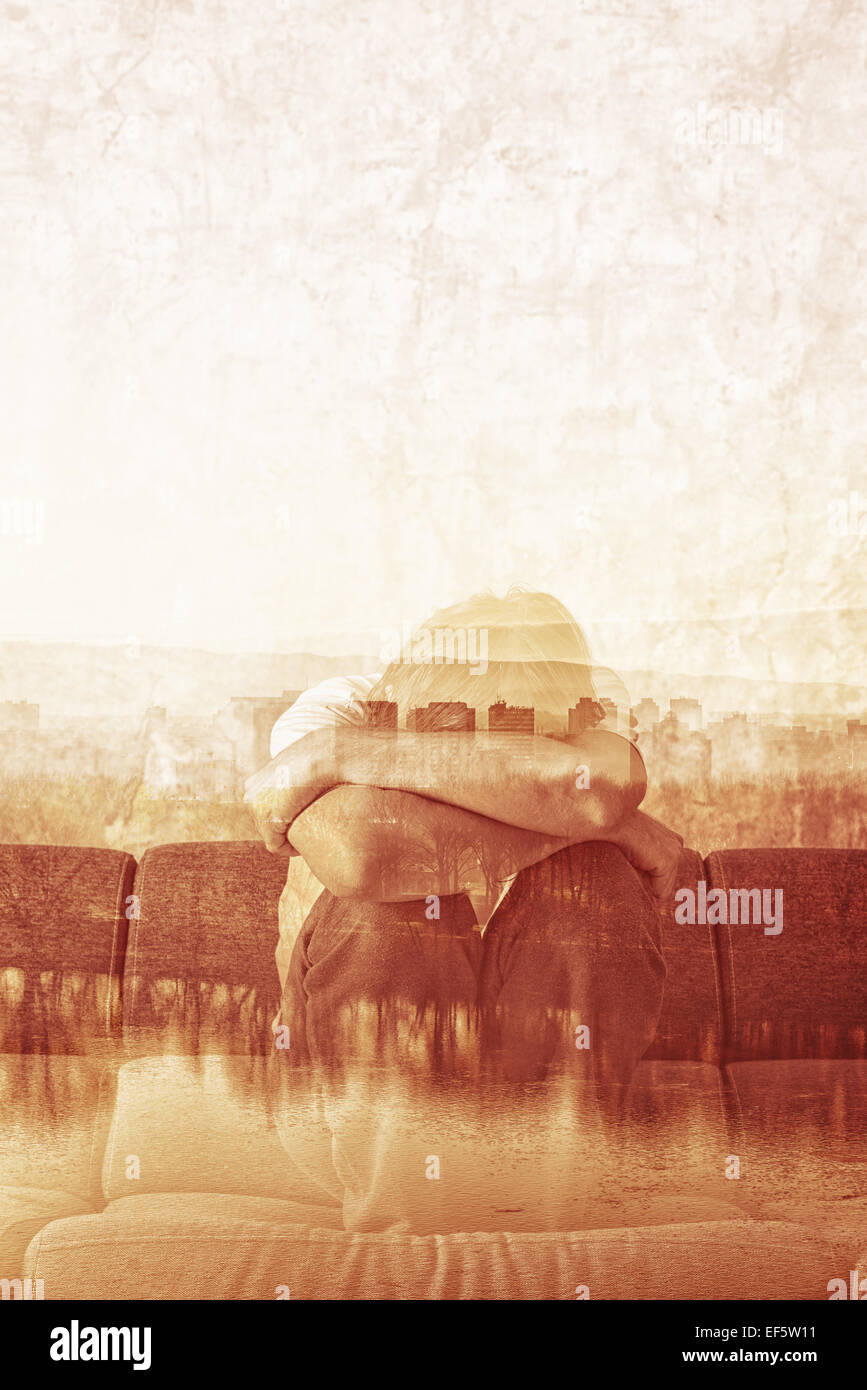 Social Alienation Concept, Depressed Man covering face and crying in despair. - Stock Image