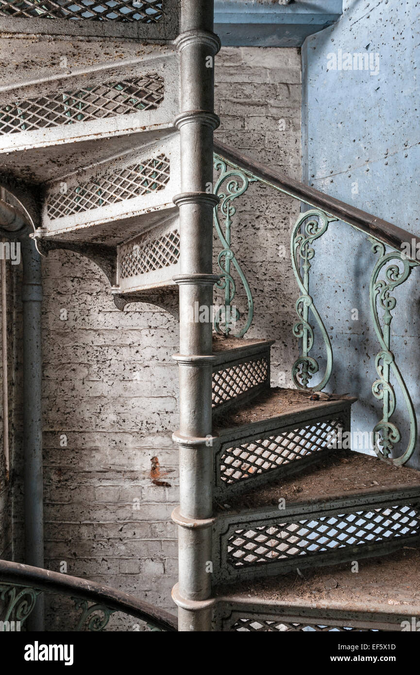 Cilcewydd Mill, Welshpool, Powys, UK. A cast-iron fireproof spiral stair runs from top to bottom of this Victorian - Stock Image