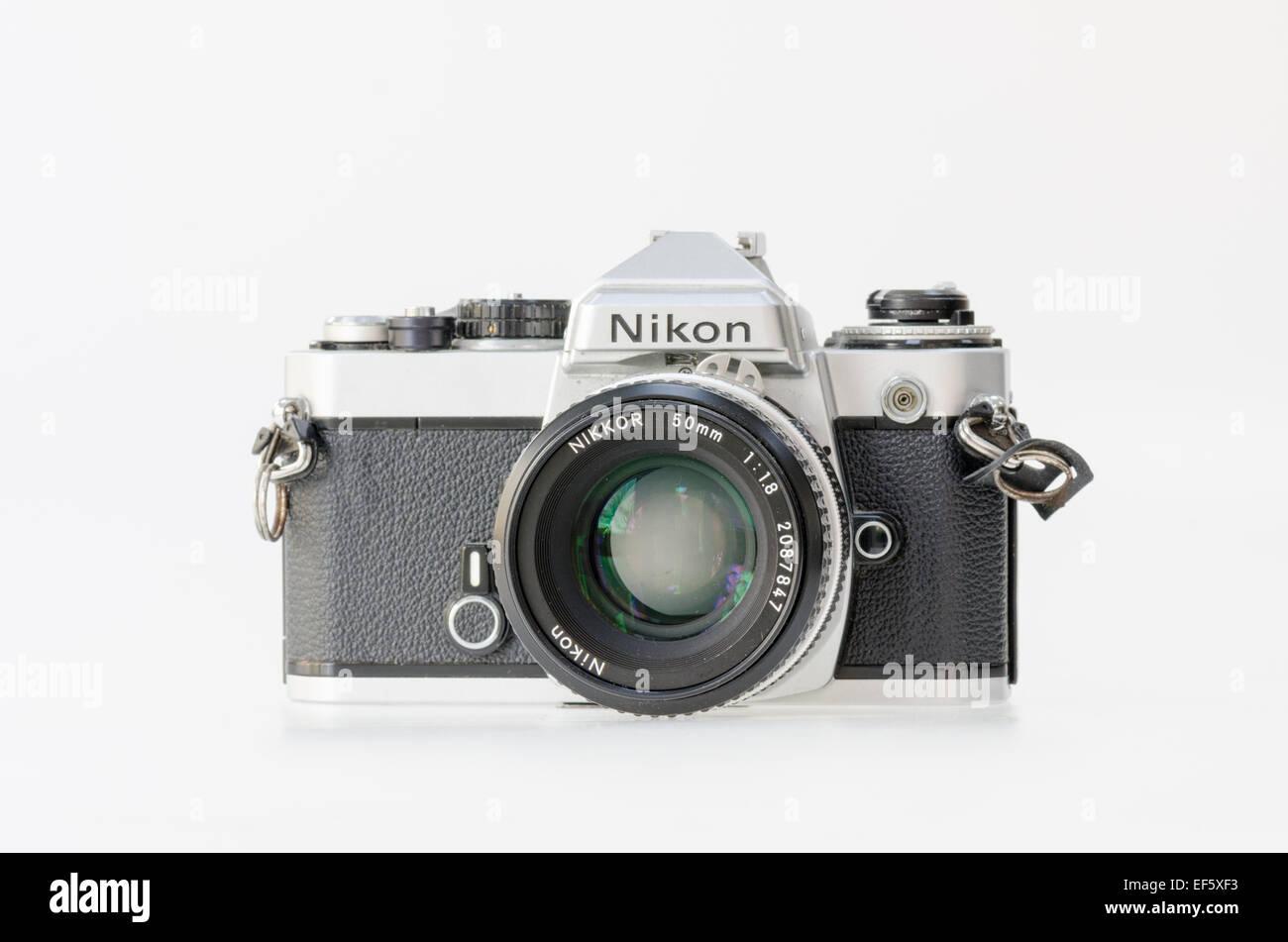 Silver Nikon FE 35mm film slr camera - Stock Image
