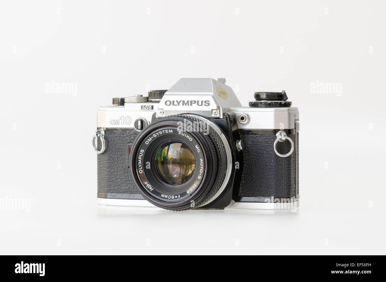 Silver Olympus OM10 35mm film slr camera - Stock Image