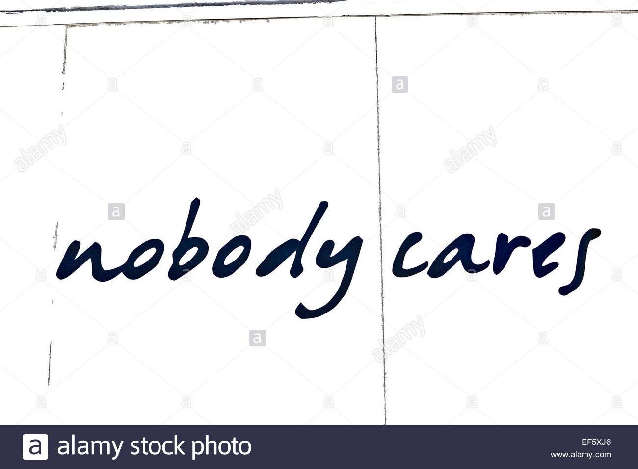 Script writing graffiti black on white: nobody cares - Stock Image