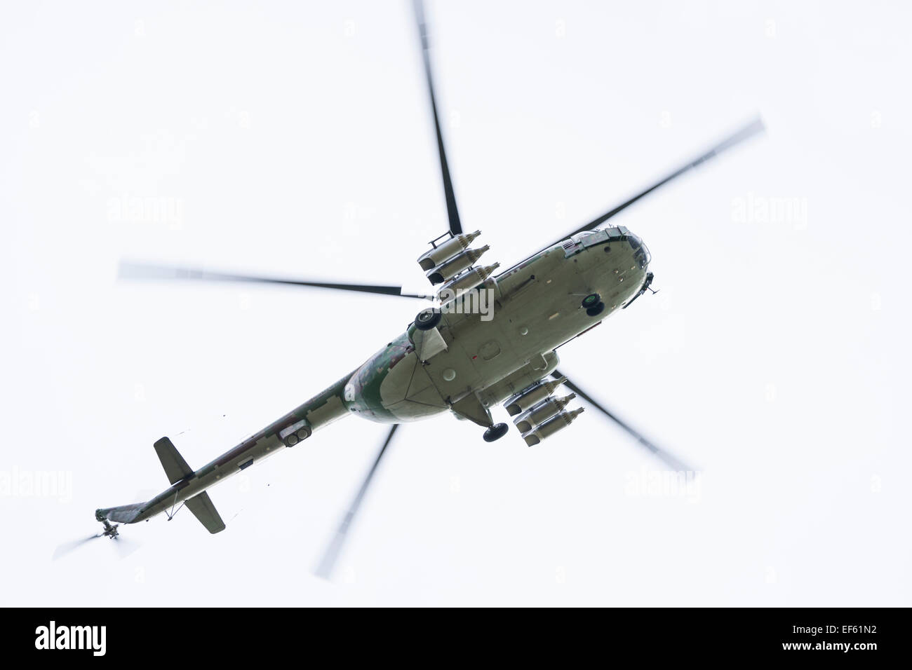 Underside view of helicopter flying in the sky, Slovakia - Stock Image