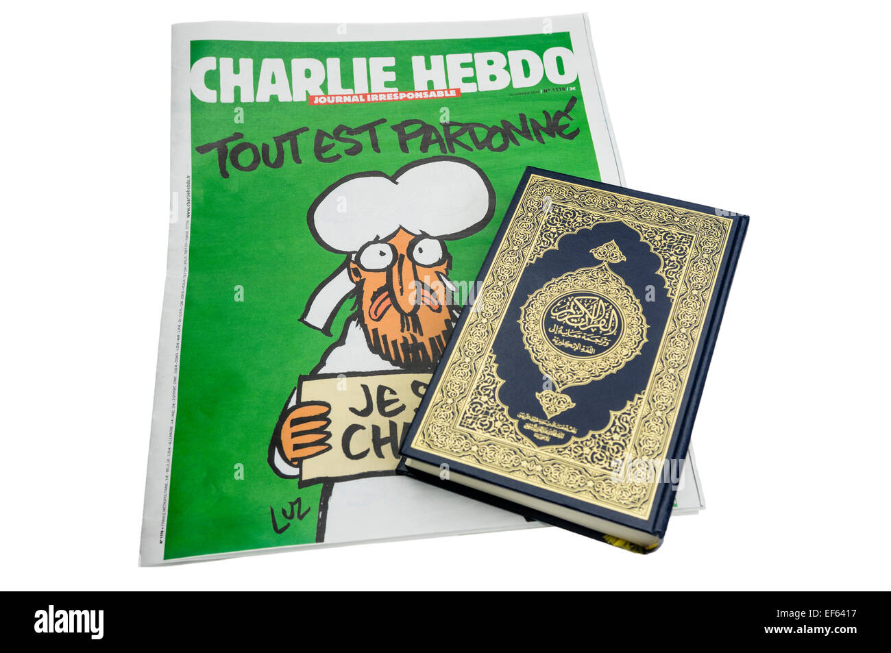 Belfast, Northern Ireland. 27 Jan 2015 - A Qu'ran sits on top of the Survivor's edition of Charlie Hebdo, - Stock Image