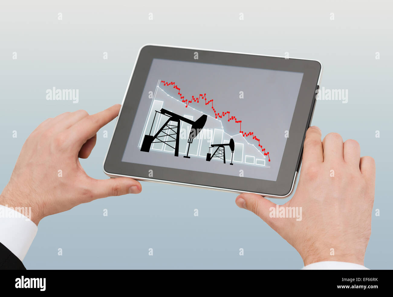 close up of man hands holding tablet pc - Stock Image