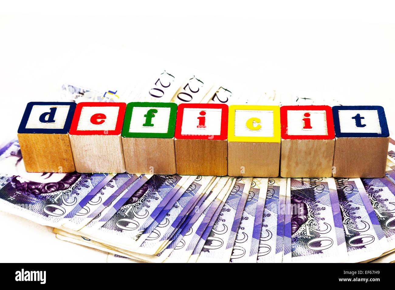 Deficit UK money shortfall owing owe debt debts austerity Copy space cut out white background cash concept word - Stock Image