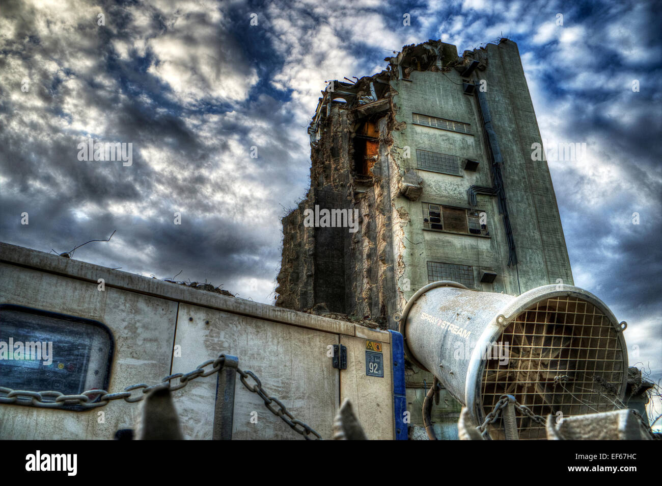 Louth Malt Kiln demolition Paul's Malt spray stream machine to dampen down dust emissions Lincolnshire UK England - Stock Image