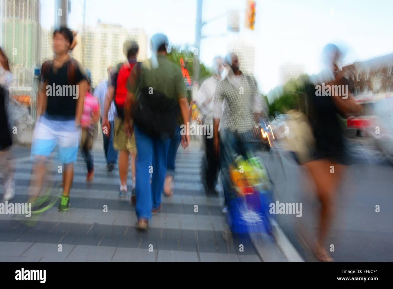 People on Crosswalk ,Toronto, Canada - Stock Image