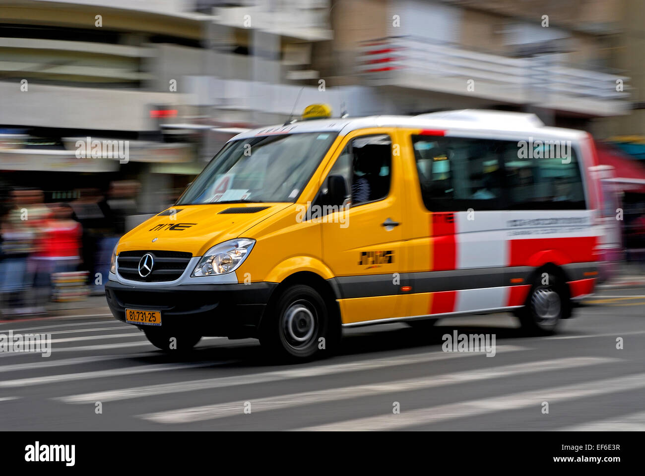 Taxi Driving in the streets of Tel Aviv in blurred motion - Stock Image