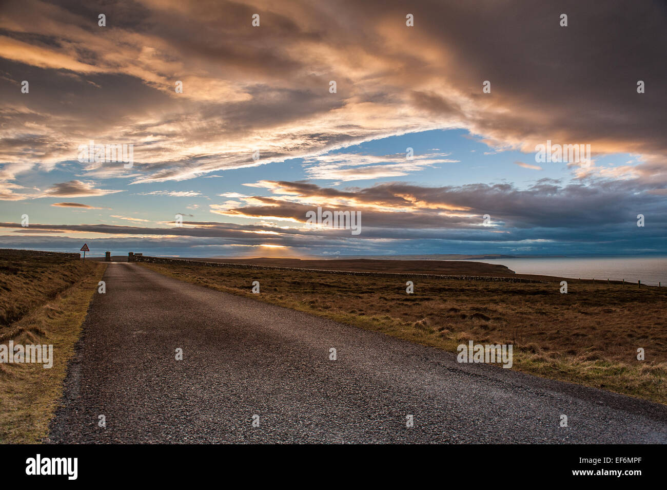 The road leading from the lighthouse at the most northerly point on the UK mainland - Stock Image