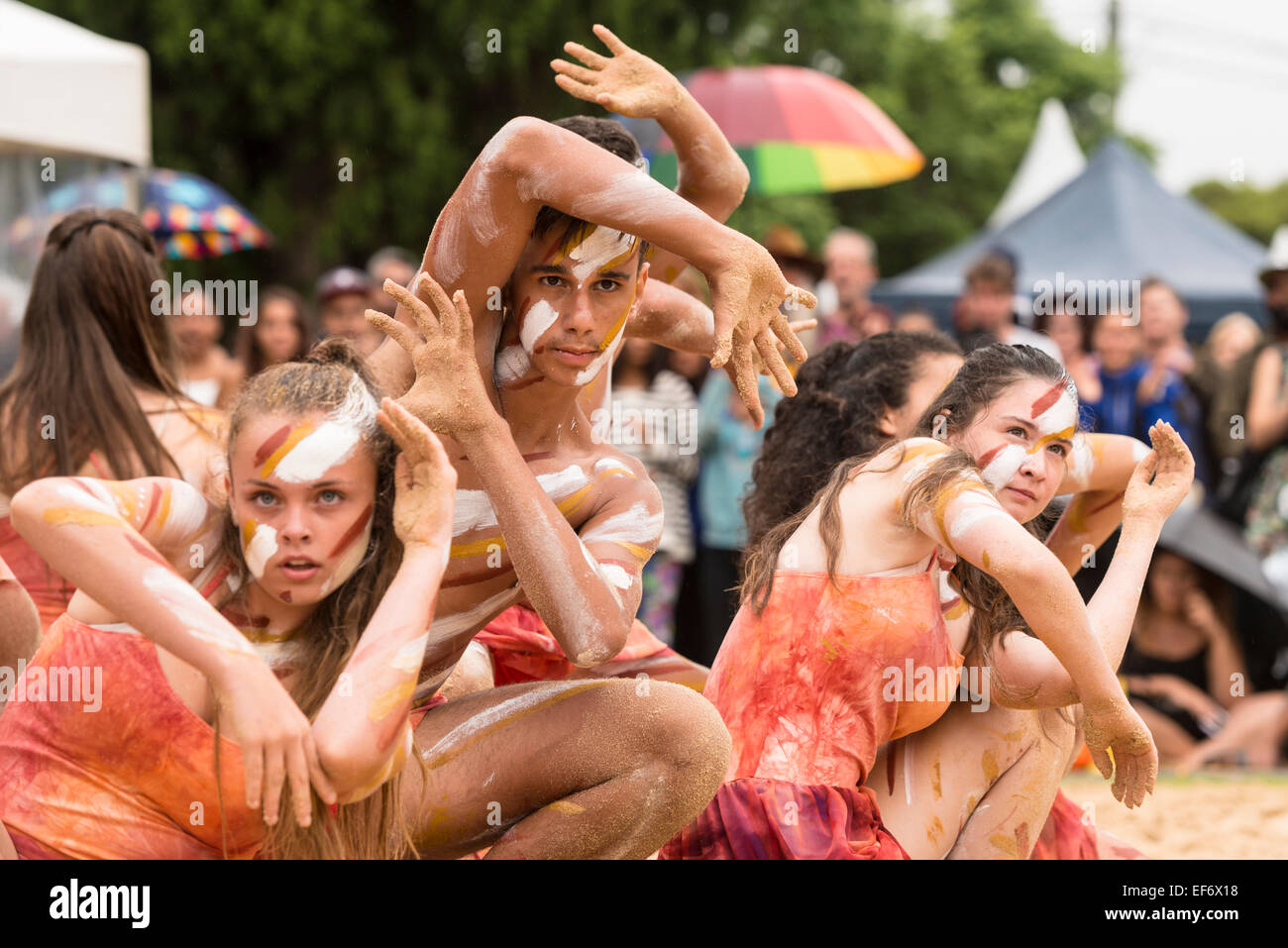Girls and boy, school children with NSW Public Schools Aboriginal Dance Company performing at Yabun Festival, Australia - Stock Image