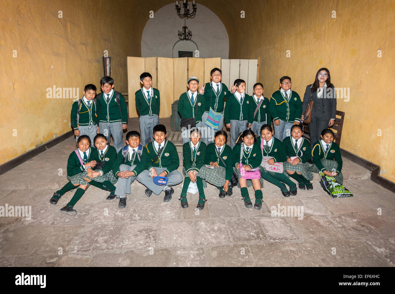 Class of local Peruvian schoolchildren in school uniform posing for a class group picture enjoying visiting Santa Stock Photo