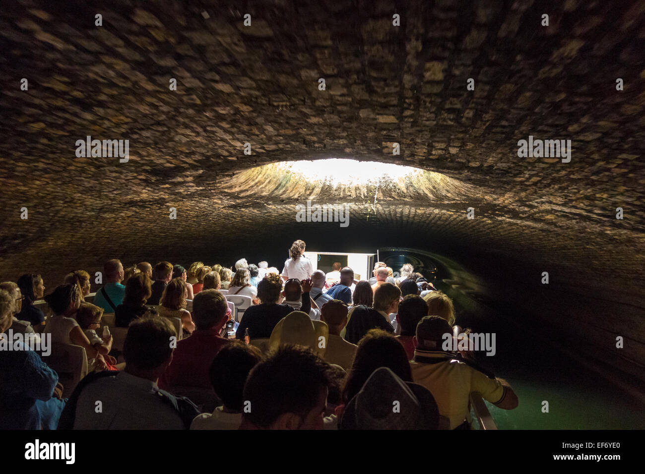 Paris Canal Saint Martin. A tourist canal cruise boat in the underground tunnel part of the Canal St Martin Paris. - Stock Image
