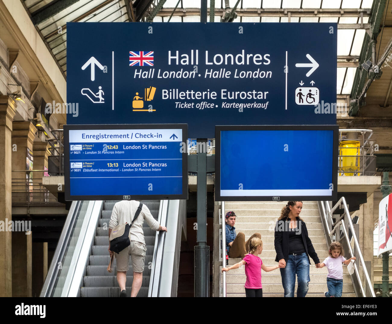 Paris Gare du Nord Station with travelers under sign pointing to Paris to London Eurostar train departure hall. - Stock Image