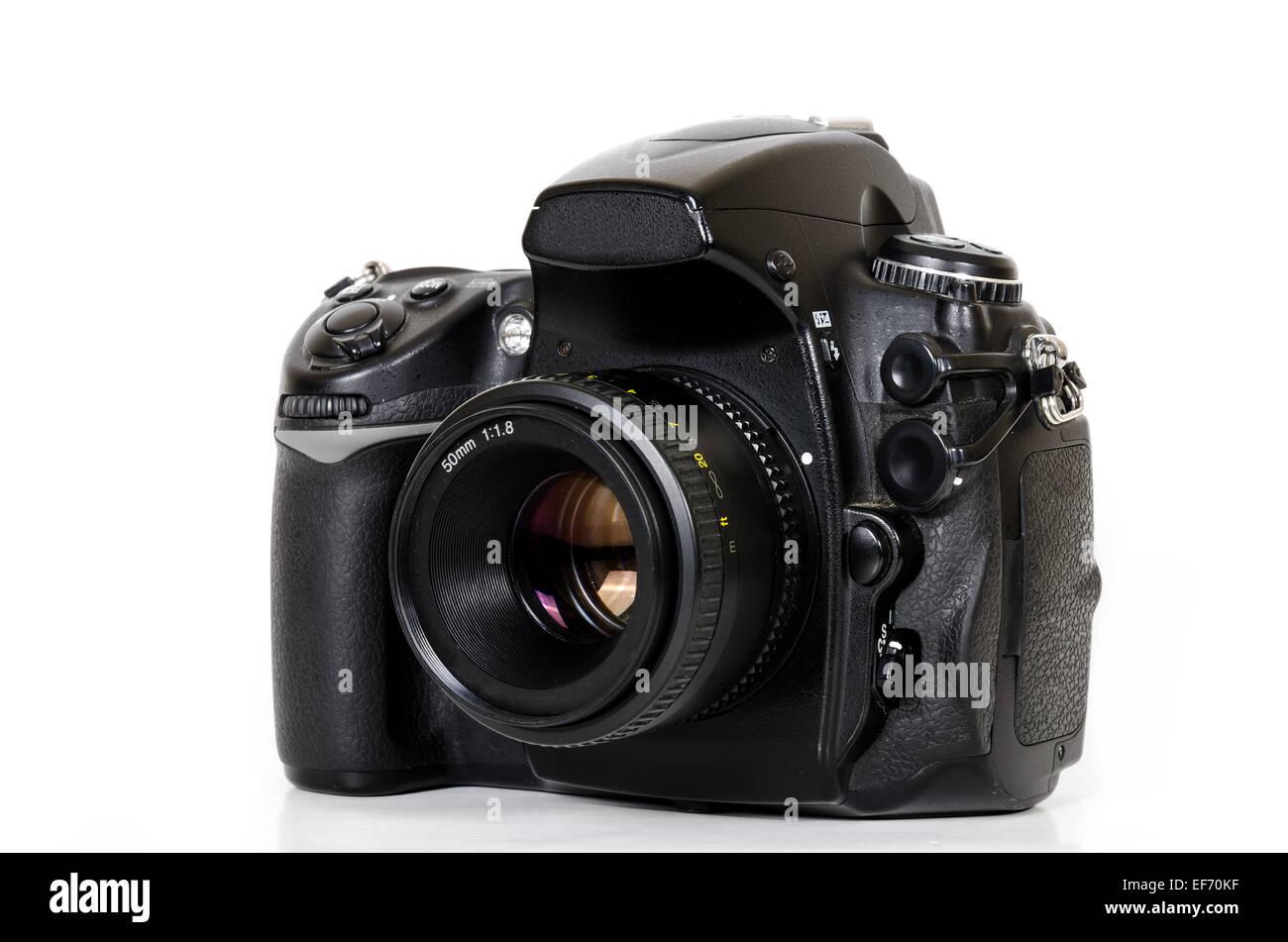 Professional digital black camera isolated on white background - Stock Image