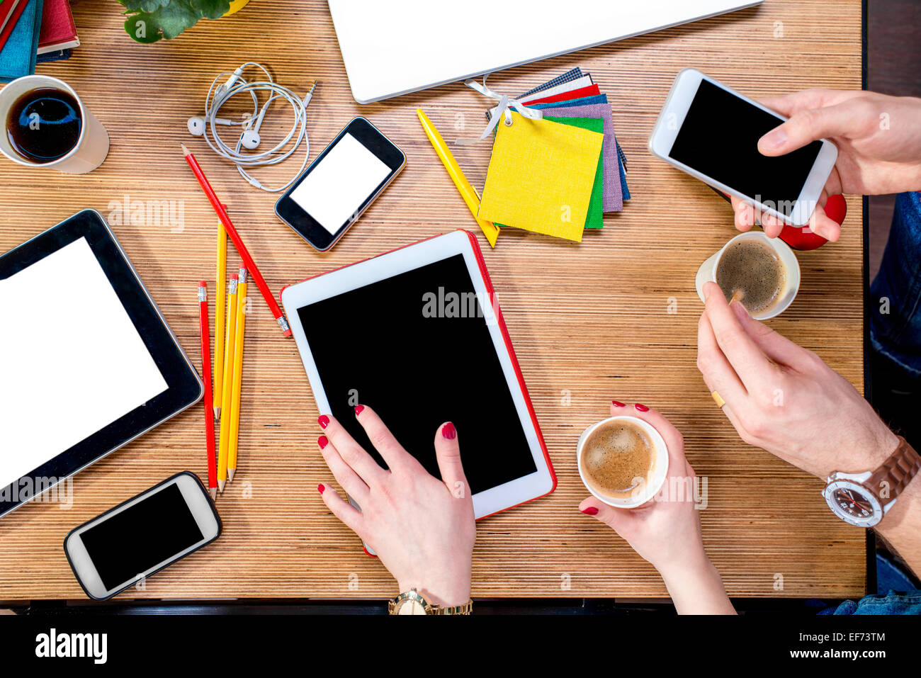 Working on table with gadgets - Stock Image