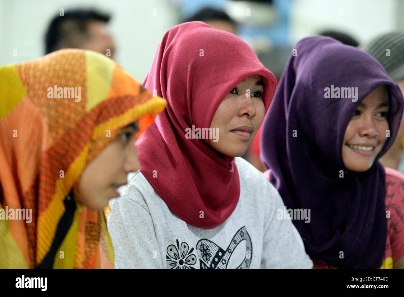 Young Muslim women with headscarves, Gampong Nusa, Aceh province, Indonesia - Stock Image