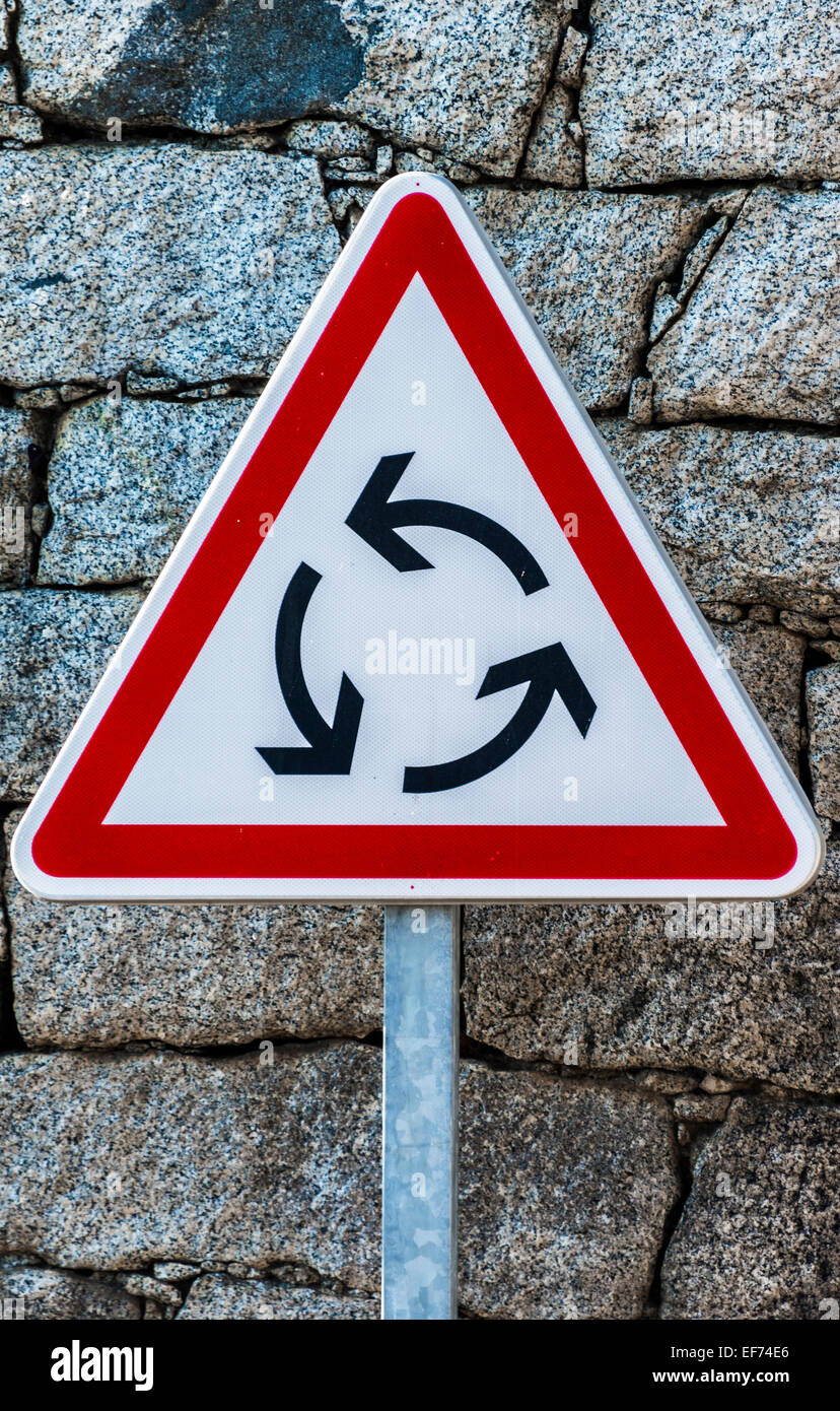 Triangular red and white road sign, roundabout - Stock Image