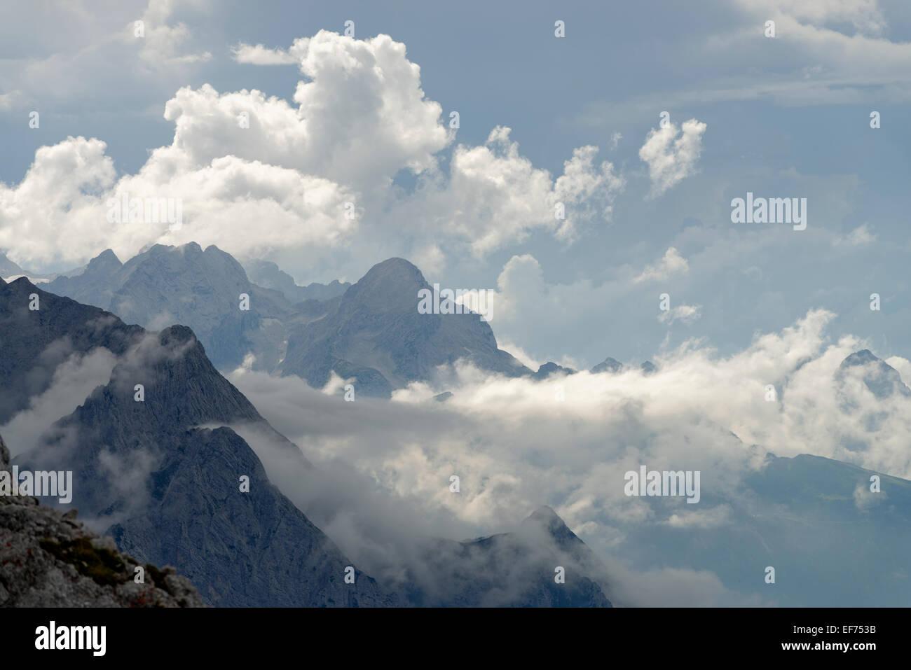 View from the Karwendelbahn, Karwendel Railway, on the Wetterstein range with Alpine peaks and atmospheric clouds - Stock Image