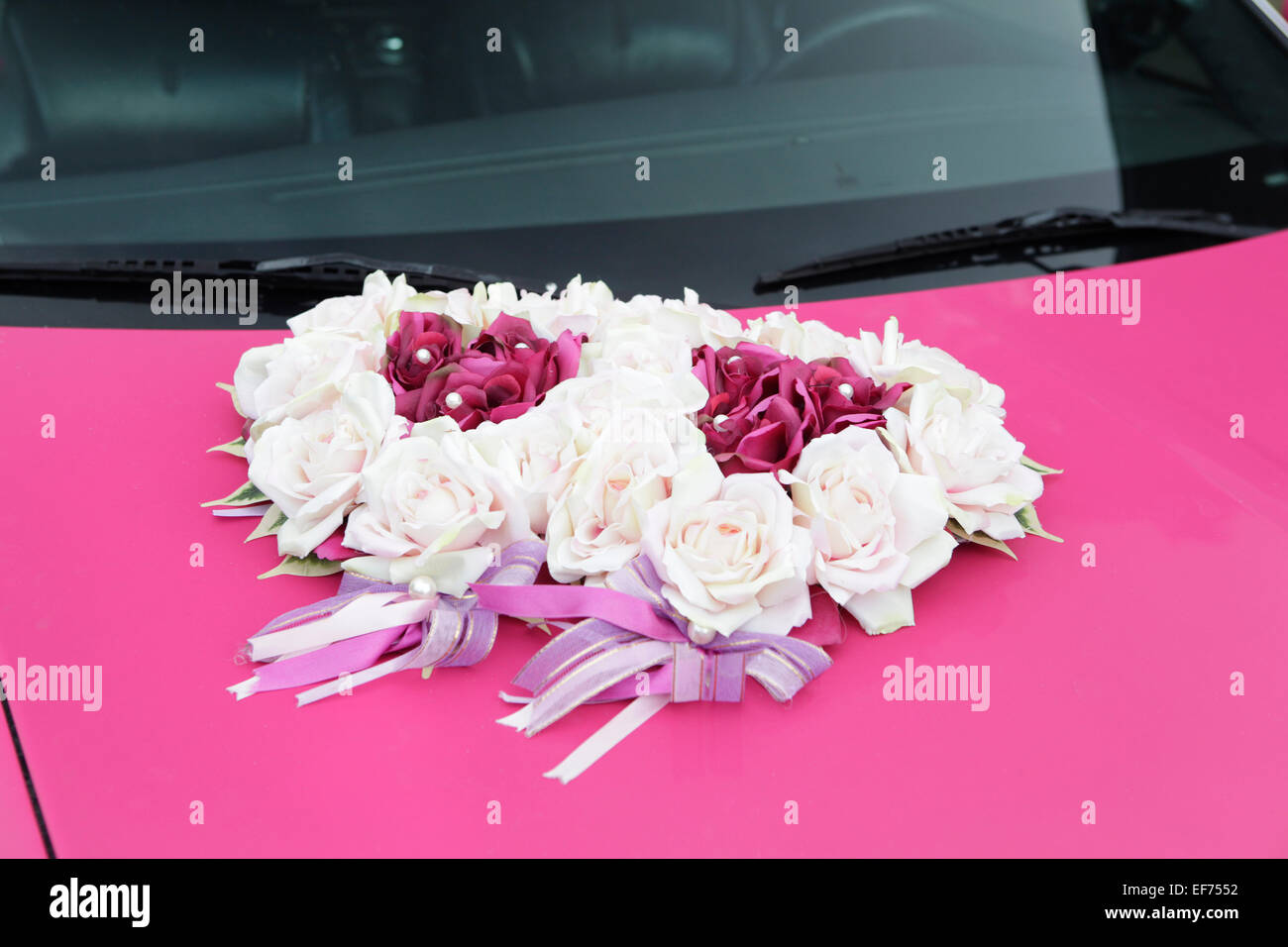 the hood of pink wedding car with flower arrangement Stock Photo ...