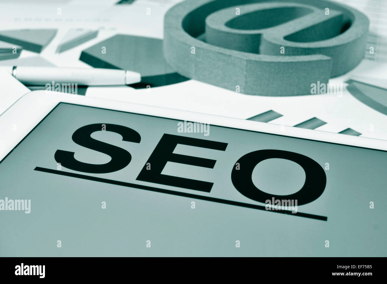 the text SEO, for Search Engine Optimization, in the screen of a tablet - Stock Image