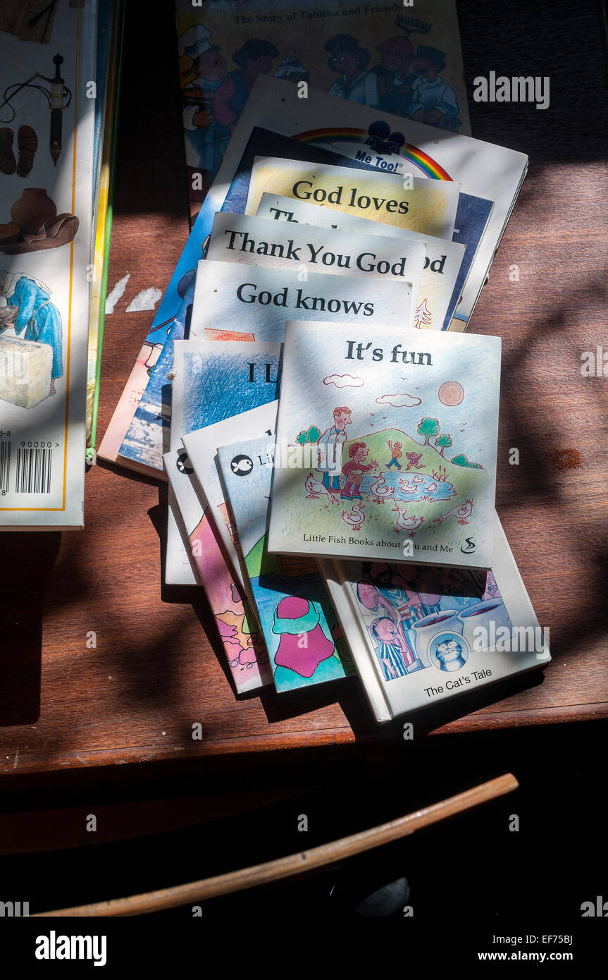 sunday school books on desk, advertisement, sign, culture, symbol, building, learning, church, wall, complex, heritage, - Stock Image