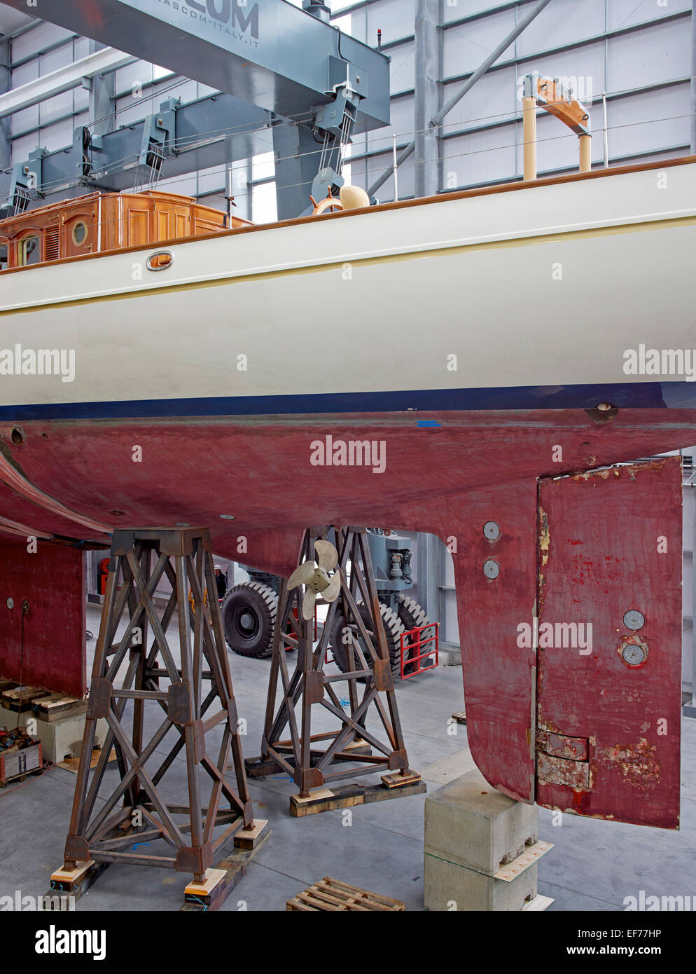 Pendennis Shipyard, Falmouth TR11 4NR, United Kingdom. Architect: na, 2014. Side elevation of yacht in dry dock. Stock Photo