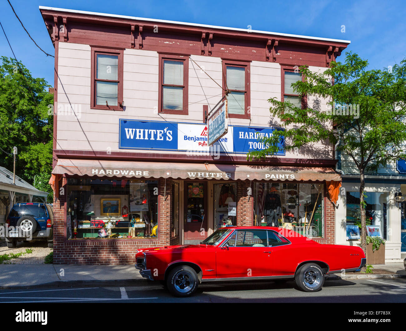 A Pontiac GTO parked outside a hardware store on Main Street in the village of Greenport, Suffolk County, Long Island, - Stock Image