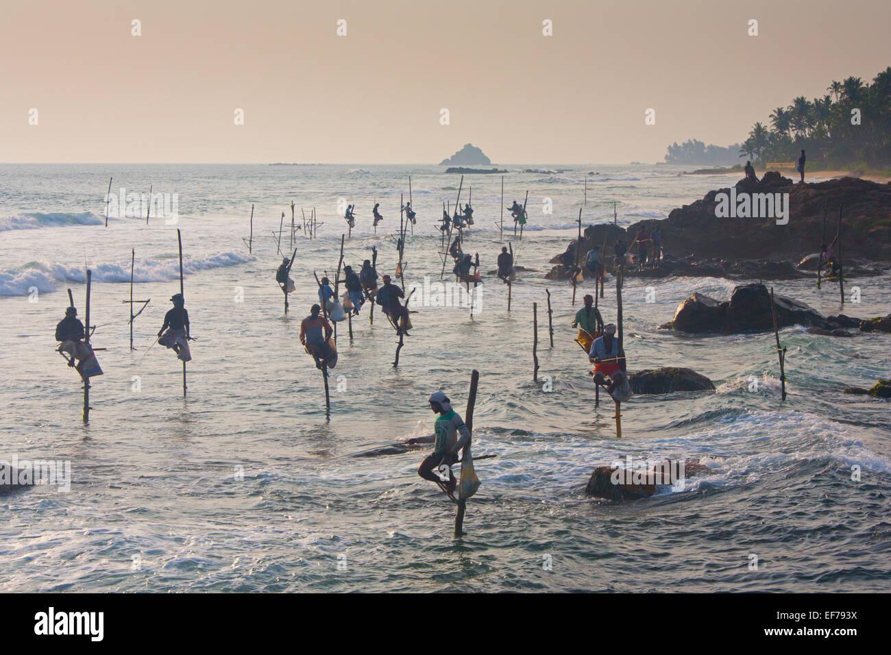 STILT FISHERMEN AT DUSK - Stock Image