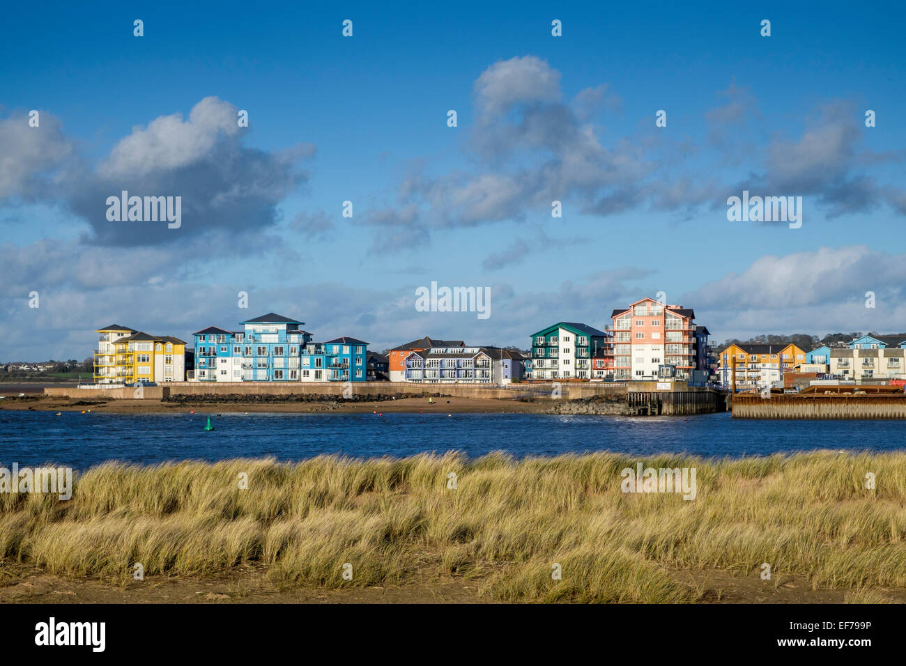 Modern apartments on Exmouth marina viewed accross the Exe estuary from Dawlish Warren - Stock Image