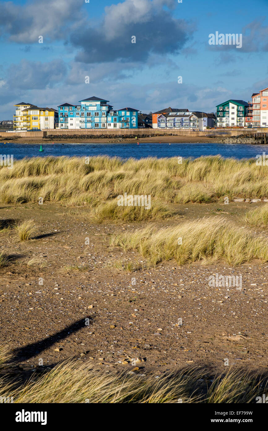 Modern apartments on the water front in Exmouth, Devon viewed from Dawlish Warren nature reserve. - Stock Image