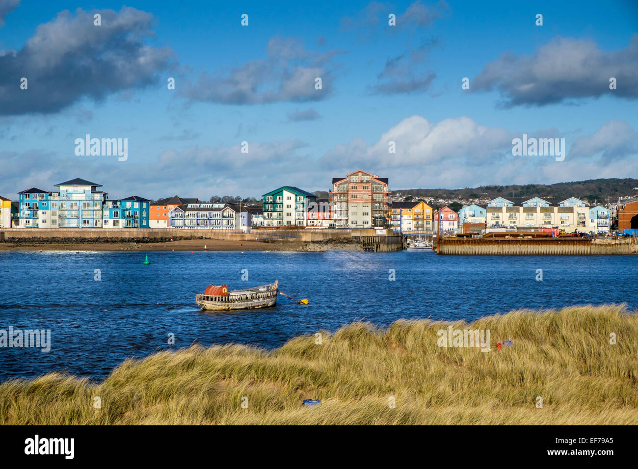 Water side apartments on the Exe estuary in Exmouth, Devon viewed from Dawlish Warren nature reserve - Stock Image