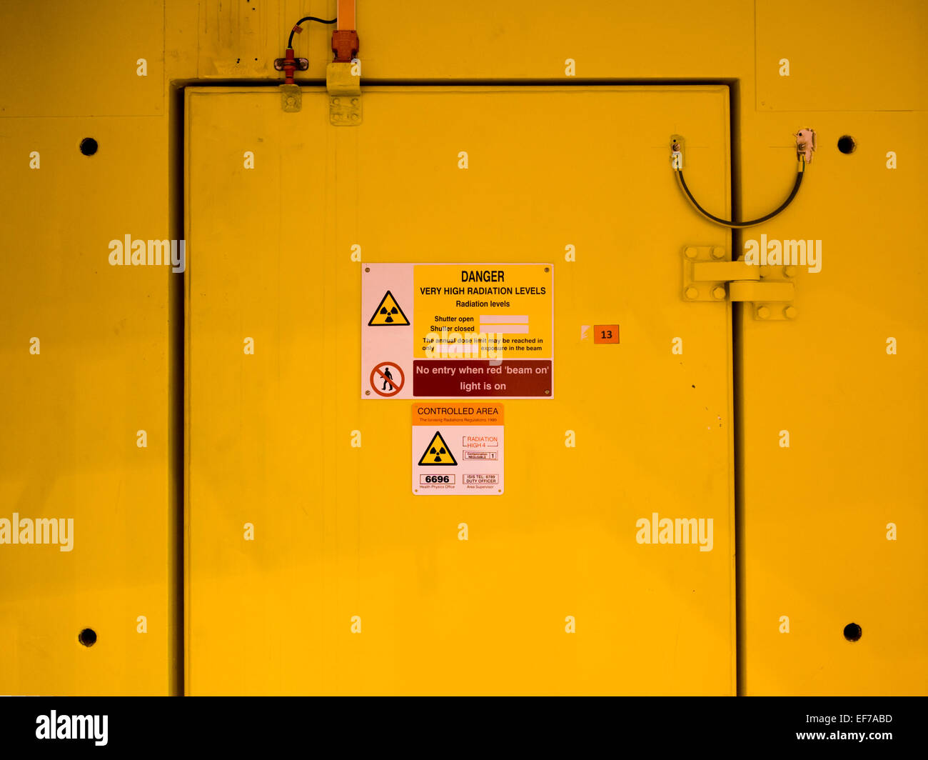 Radiation sign on Yellow door at Rutherford Appleton Laboratory - Stock Image