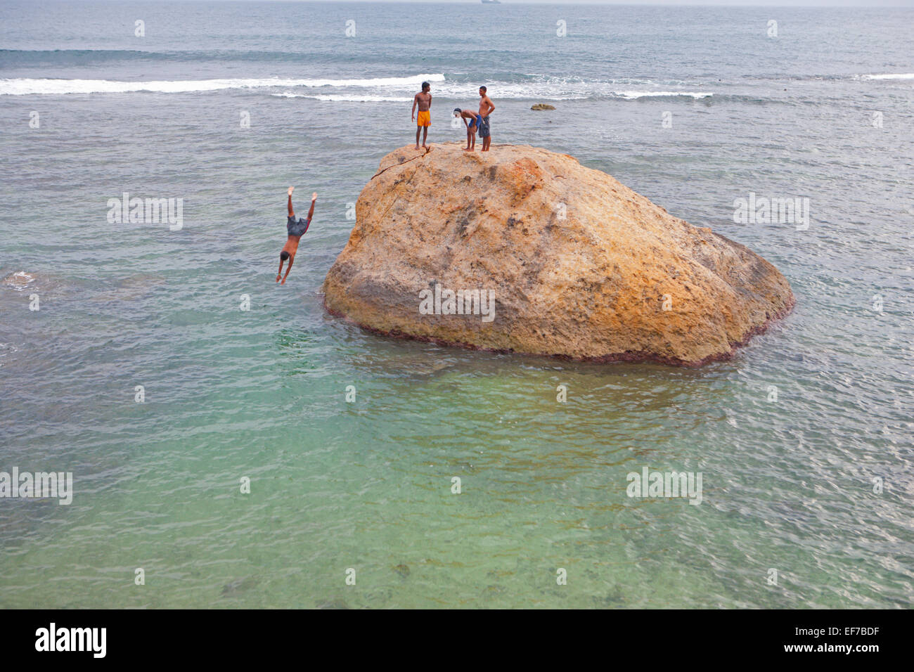 CLIFF DIVING AT GALLE FORT - Stock Image