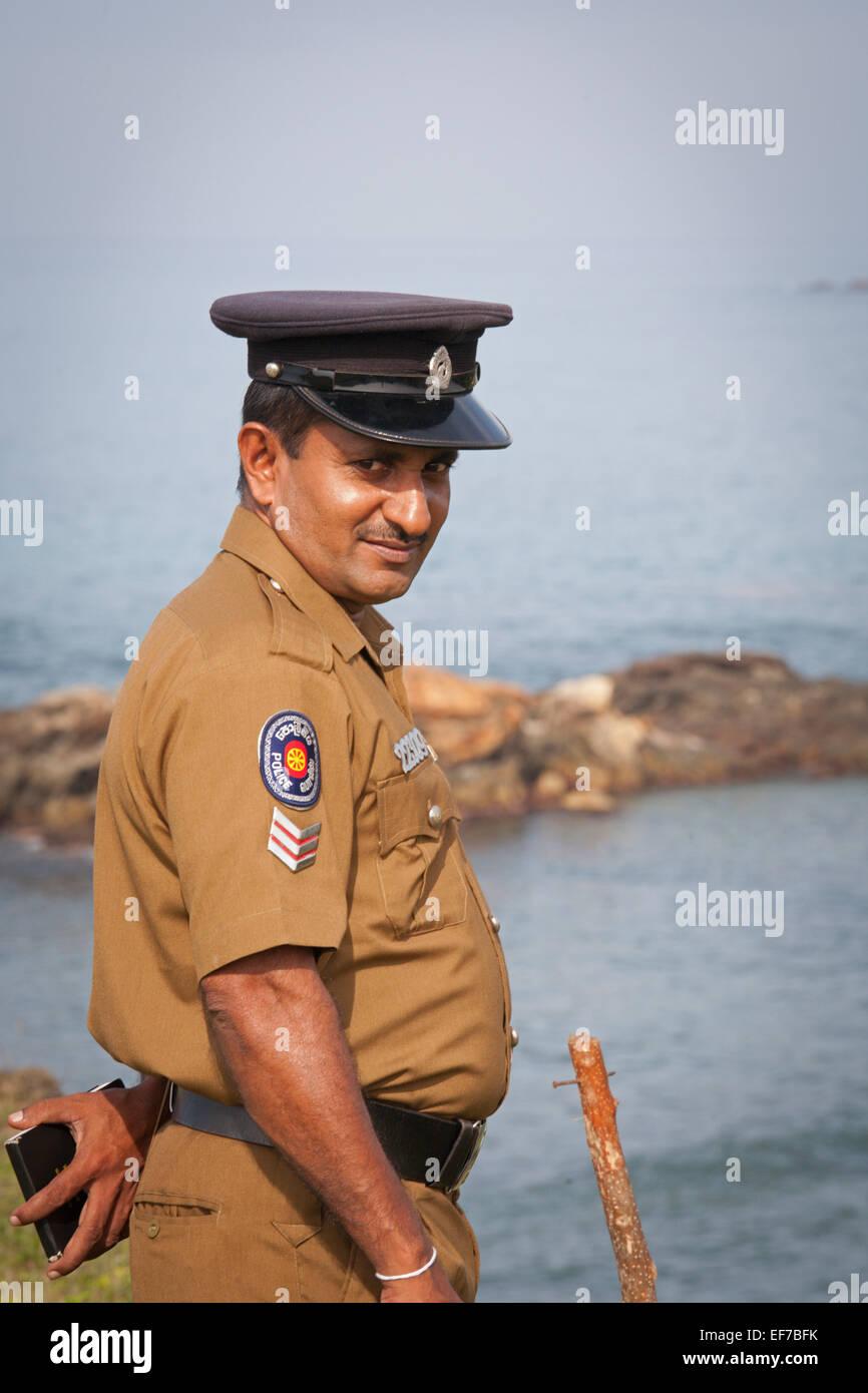 SRI LANKAN POLICE MAN AT GALLE FORT - Stock Image