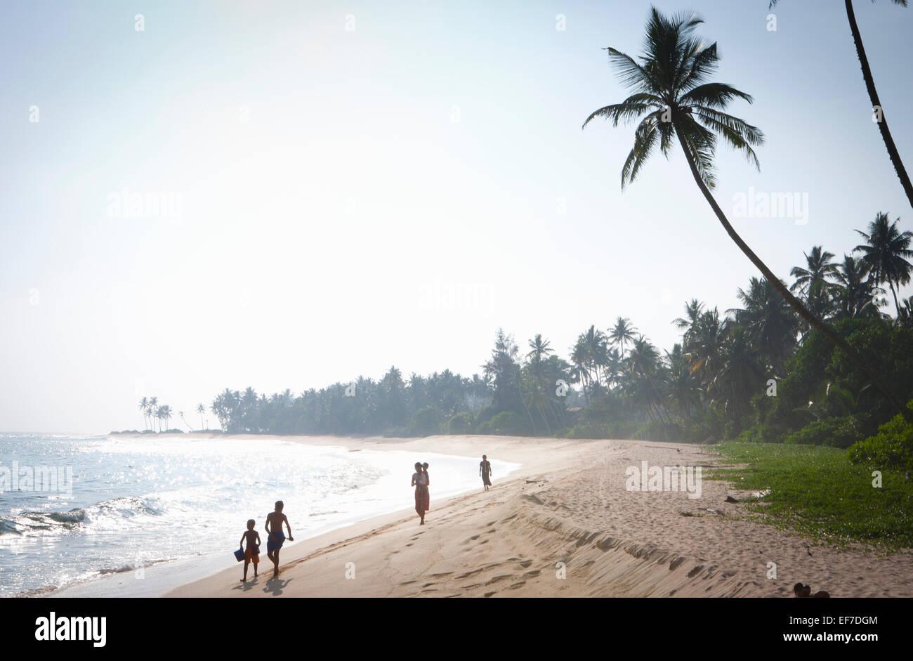 SRI LANKAN FAMILY ON BEACH - Stock Image