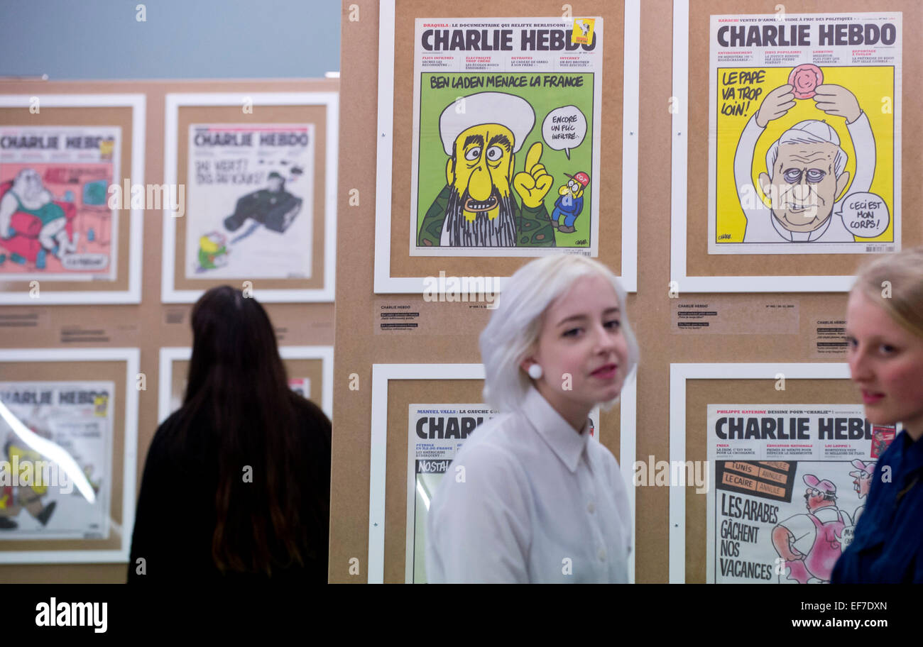 An exhibition presenting nearly 200 front pages of the French satirical magazine Charlie Hebdo, whose Paris editors - Stock Image