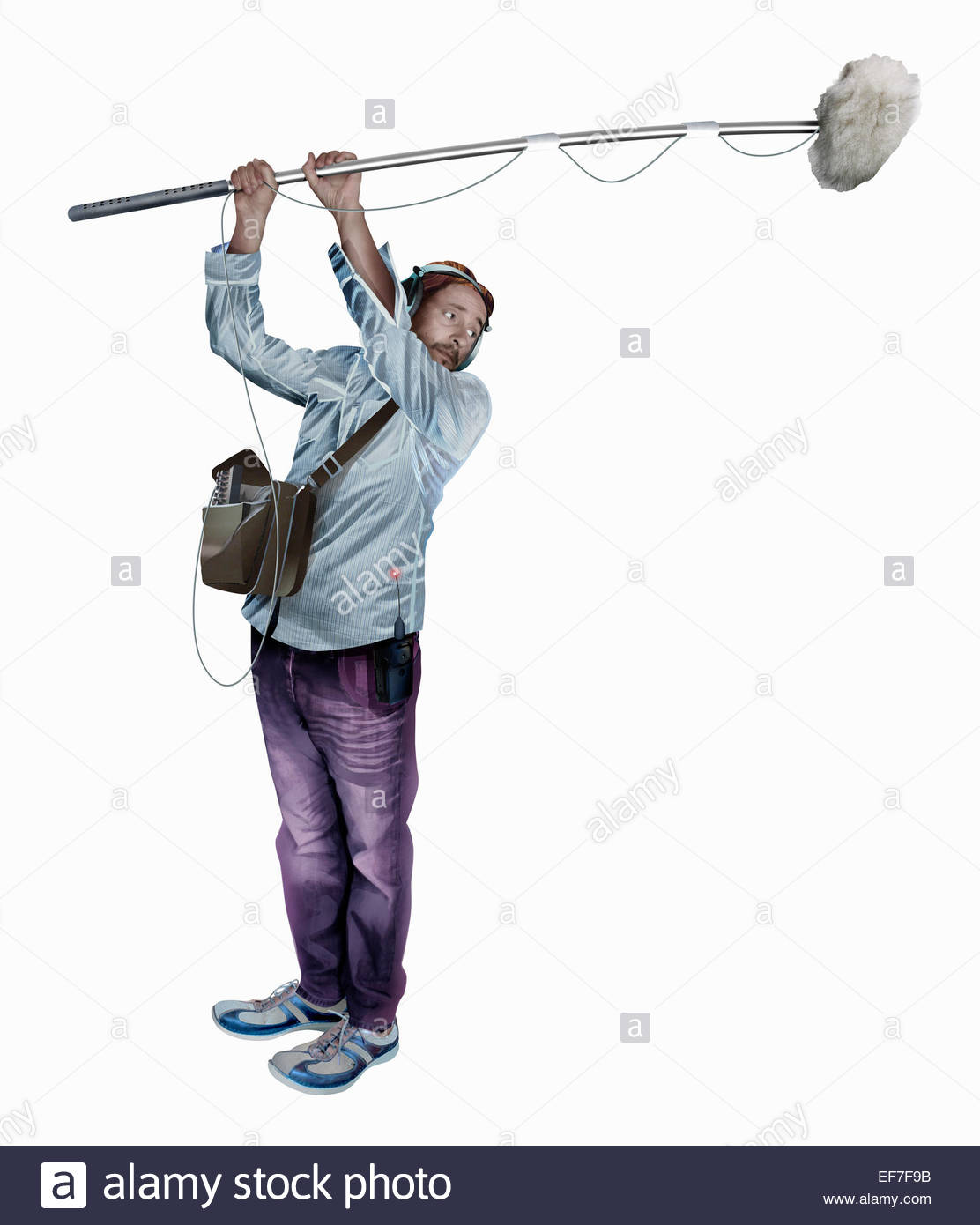 Sound technician holding boom microphone Stock Photo
