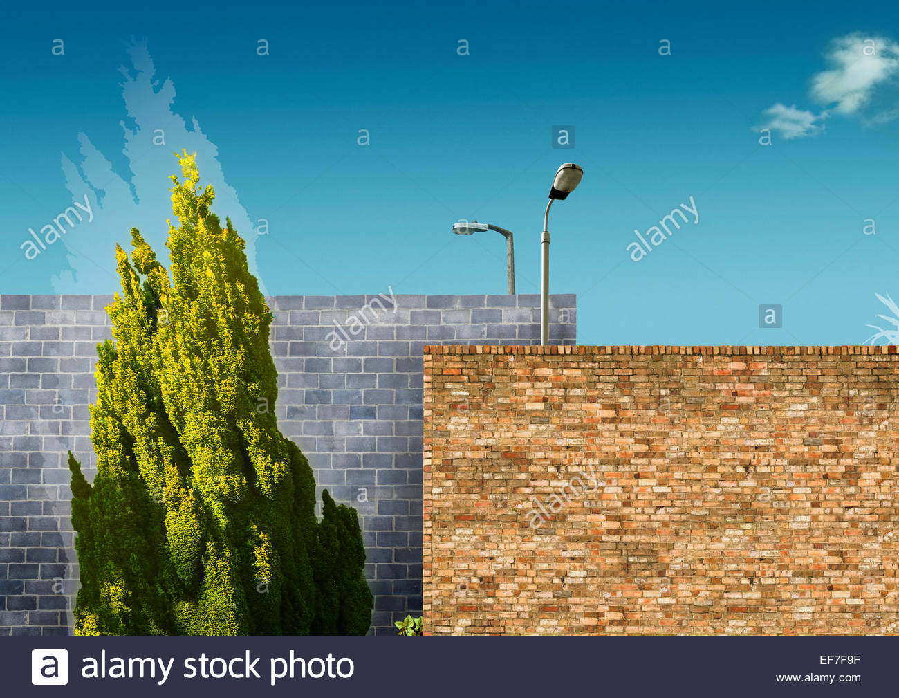 Barrier of two brick walls with street lamps - Stock Image