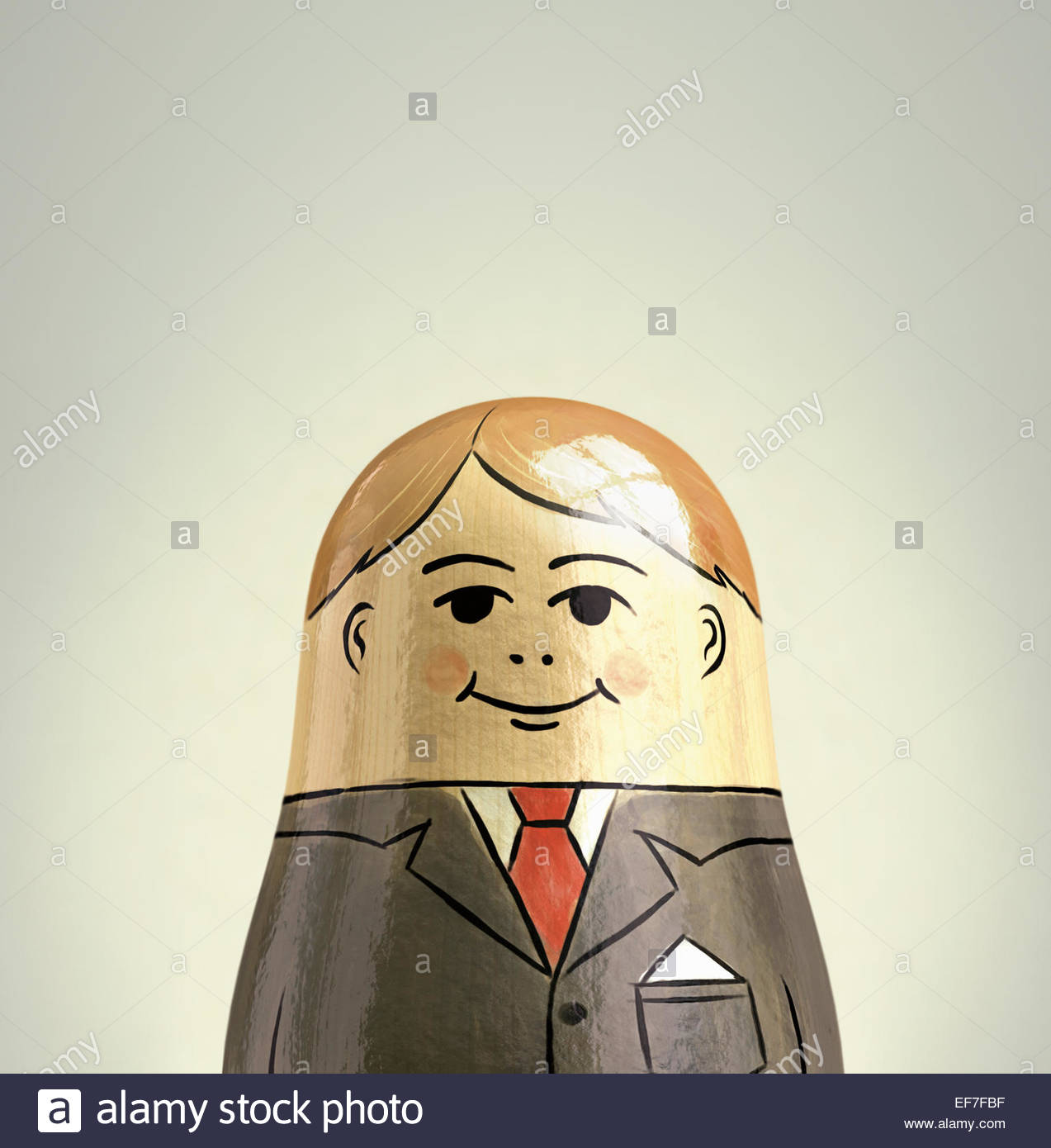 Happy, smiling businessman nesting doll - Stock Image