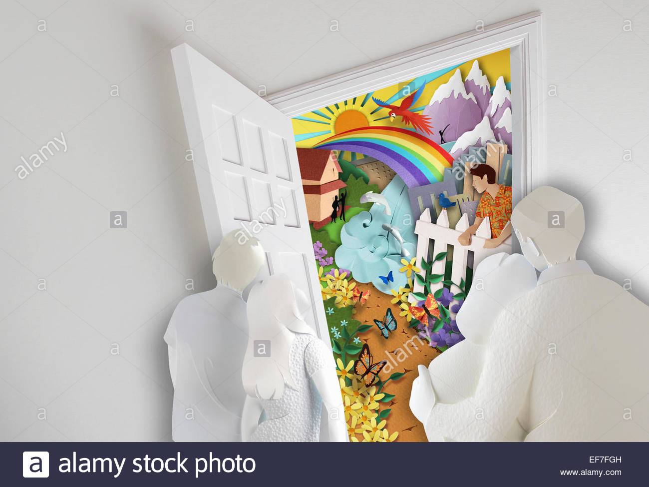 Family looking out doorway to bright colorful opportunity - Stock Image