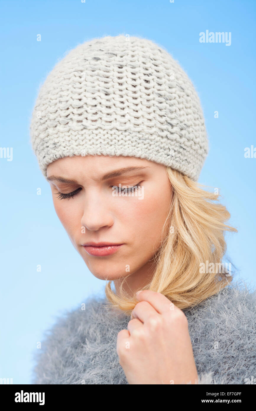 Beautiful woman touching her hair - Stock Image