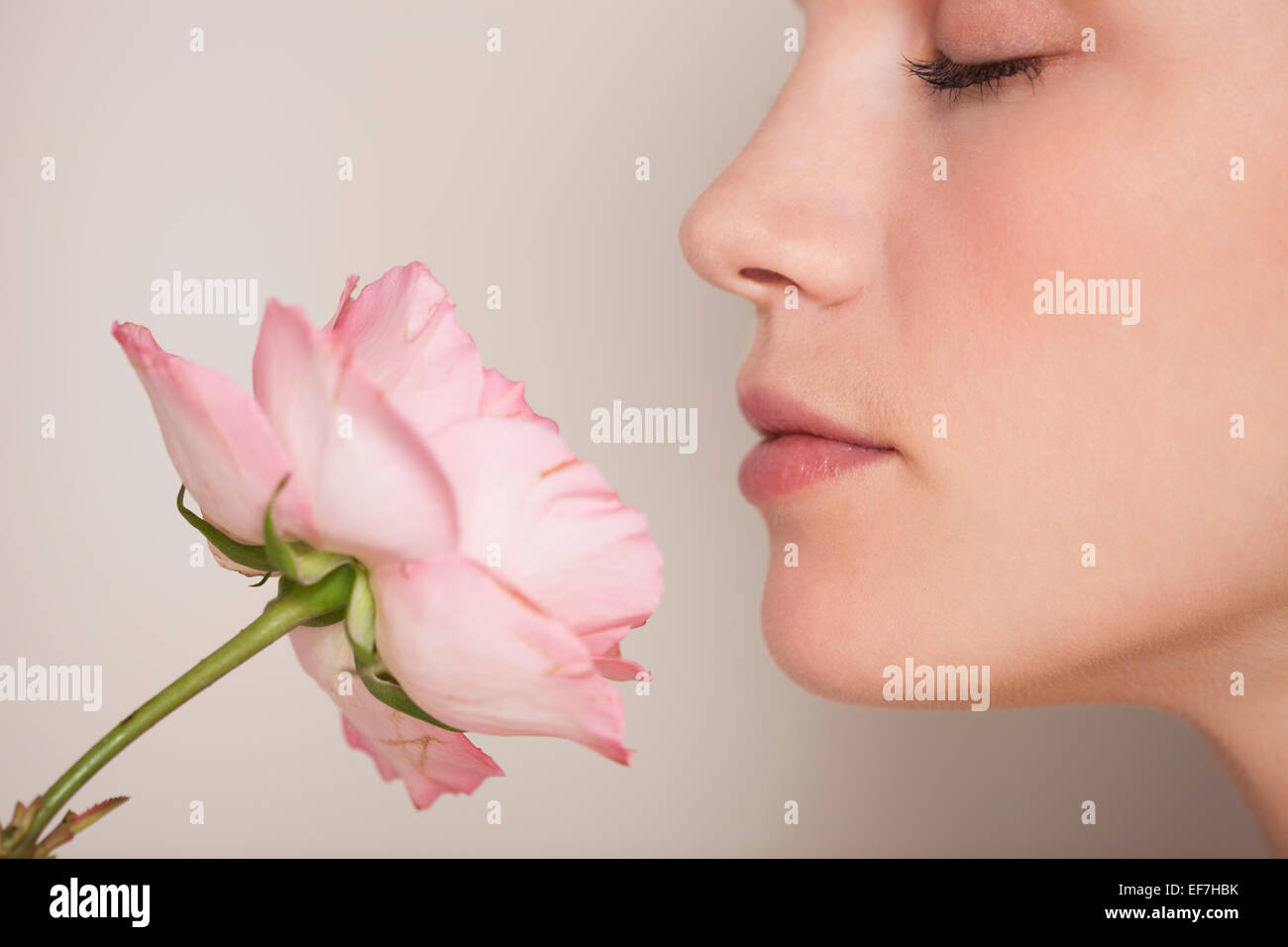 Beautiful woman smelling a flower Stock Photo