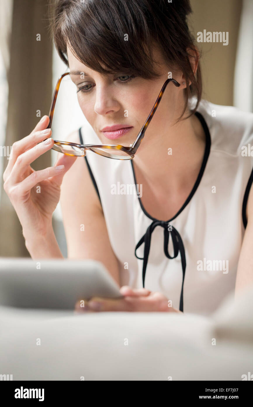 Woman looking at a digital tablet Stock Photo