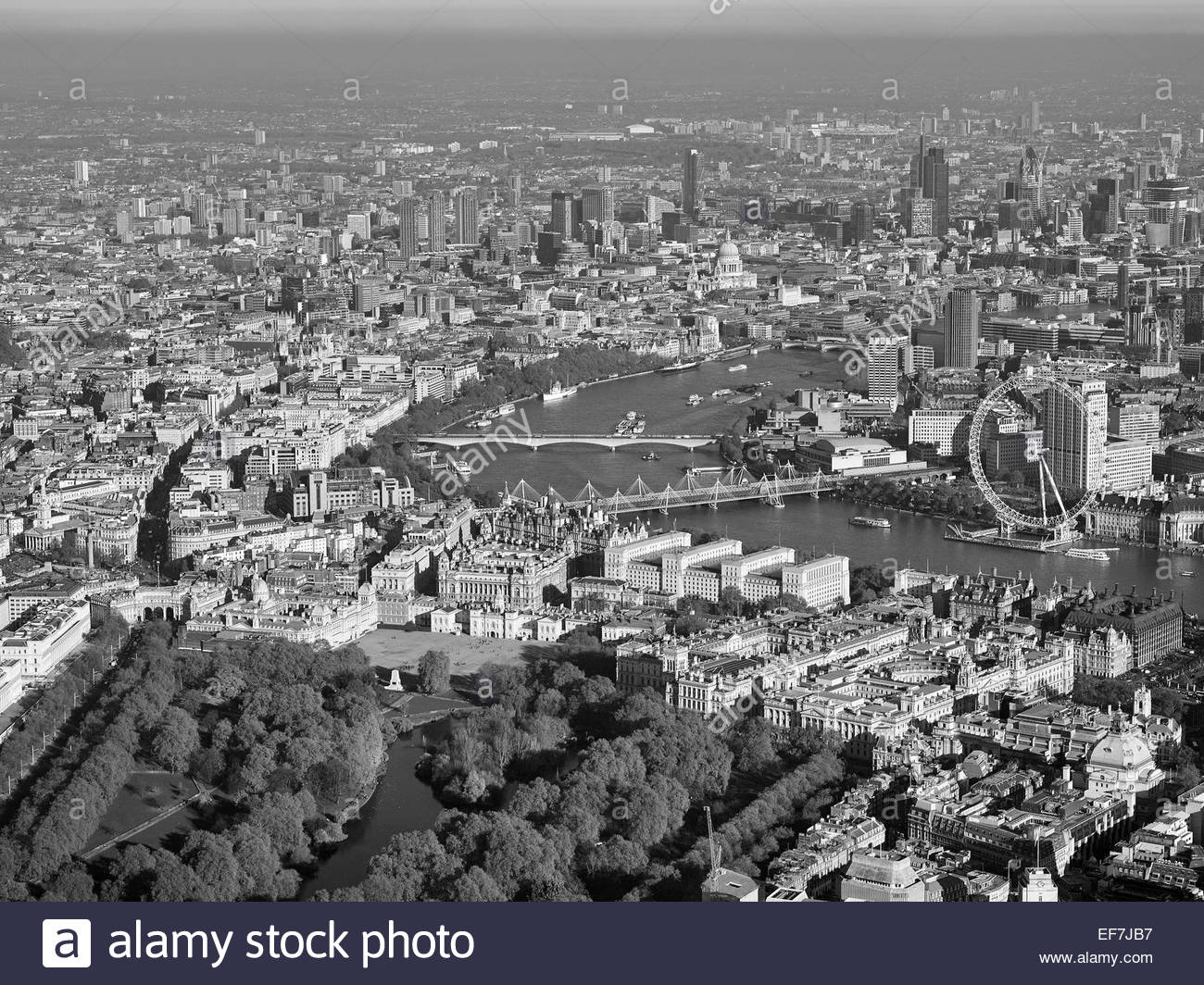 The River Thames from the air, Central London, UK looking East towards the City, Hungerford Bridge and the Eye right - Stock Image