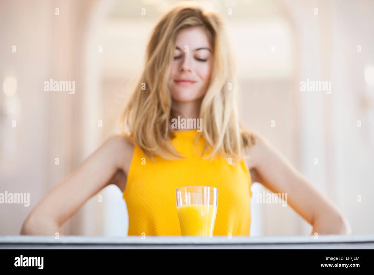 Woman with orange juice - Stock Image