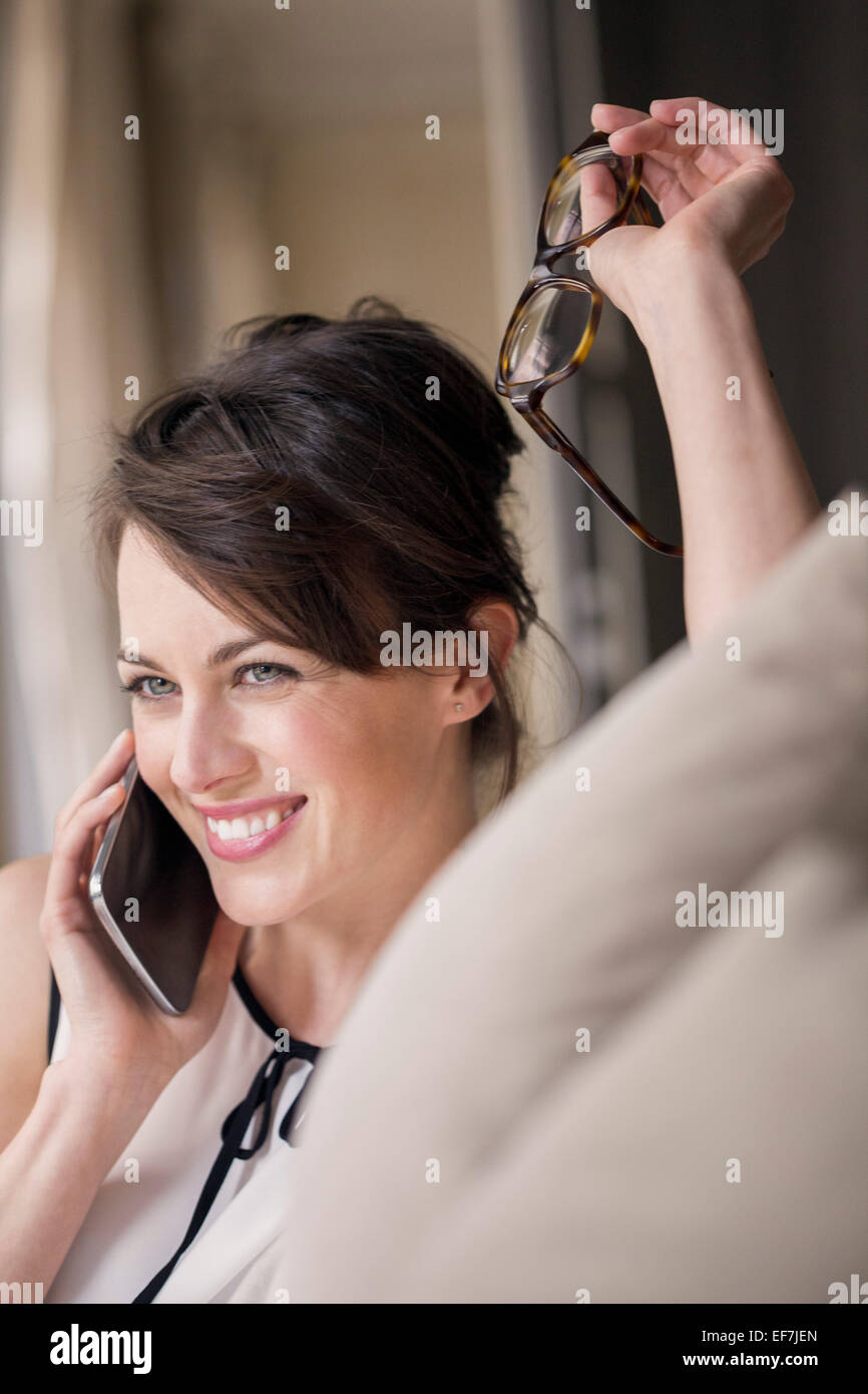 Beautiful woman talking on a mobile phone - Stock Image