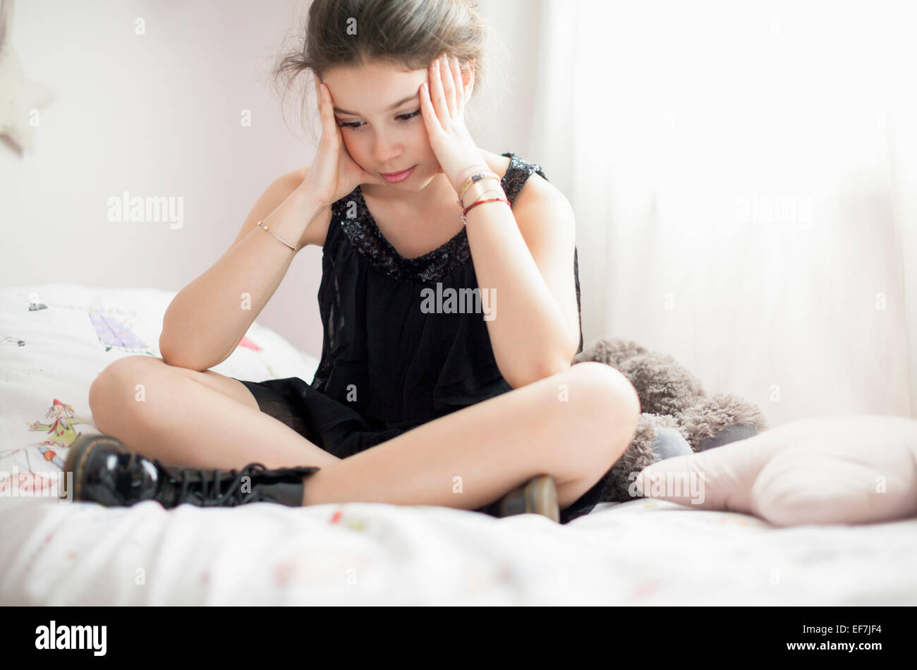 Girl thinking on the bed Stock Photo