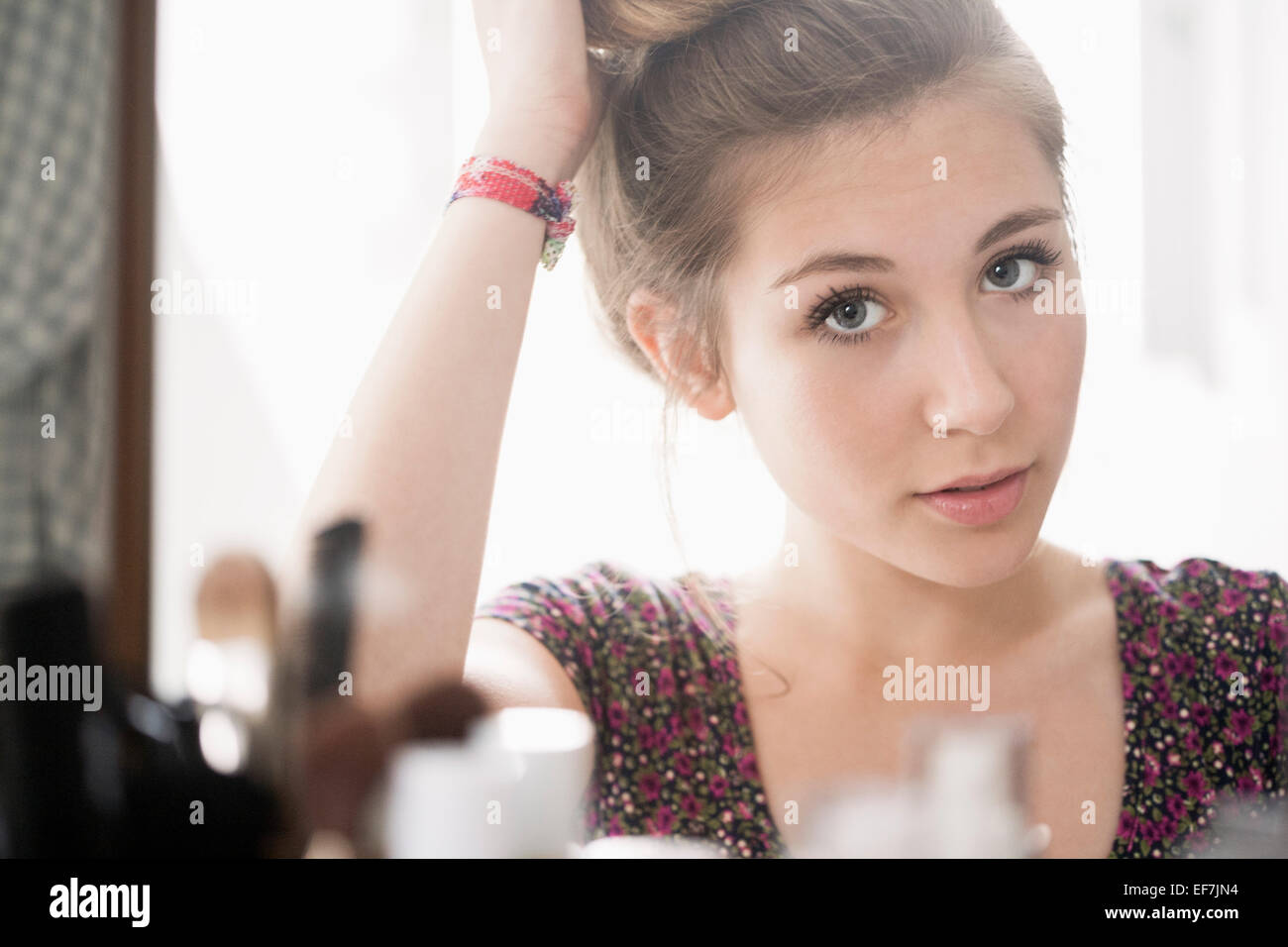Teenage girl looking at mirror - Stock Image