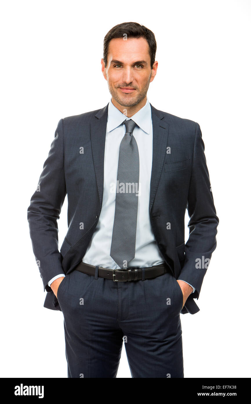 Half length portrait of a businessman with hands in his pockets - Stock Image