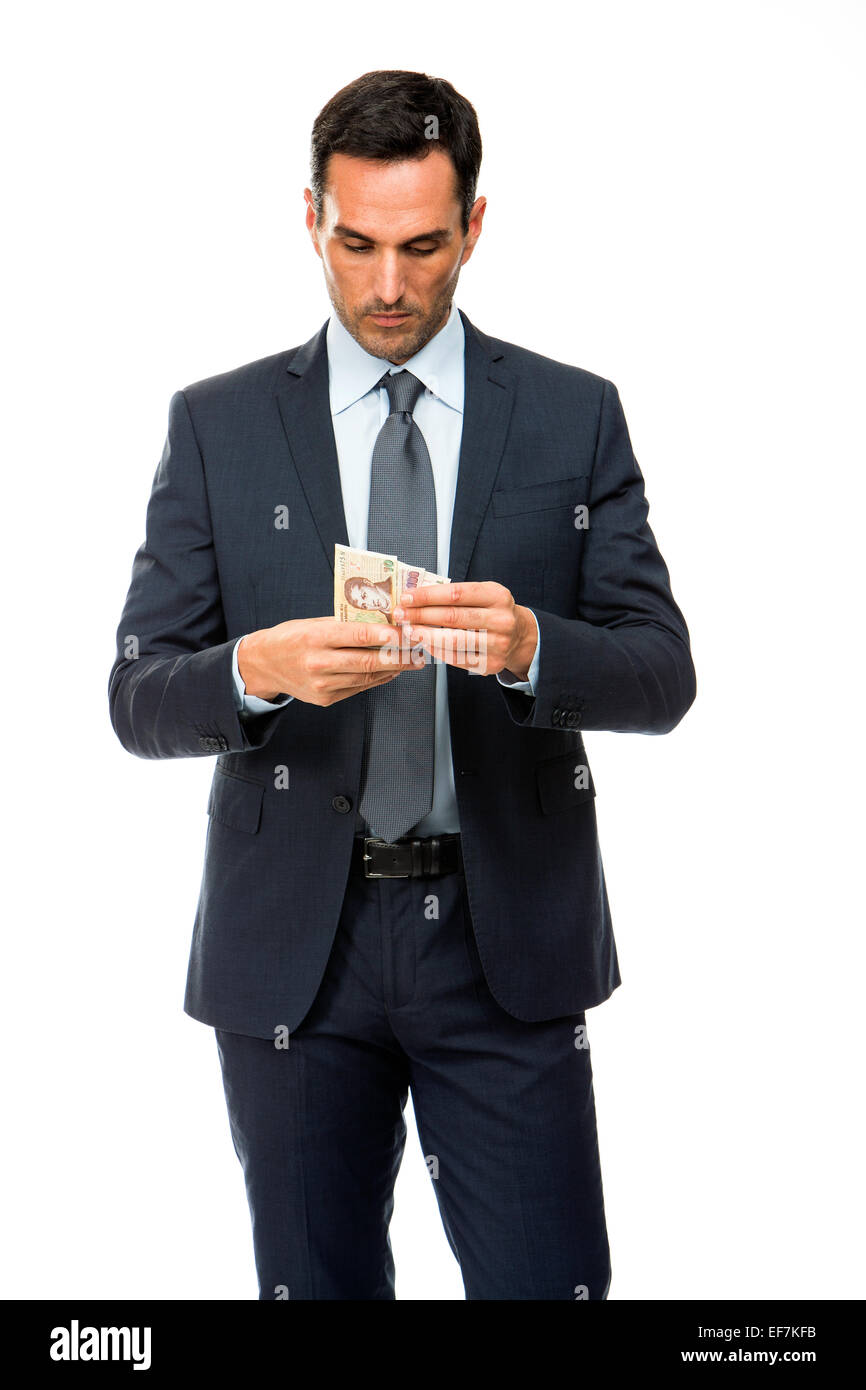 Half length portrait of a businessman counting money - Stock Image